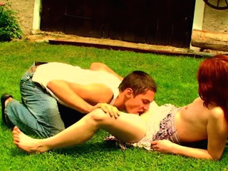 Filthy redhead whore is fucking with her partner on the grass