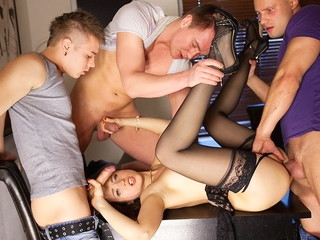 Lewd underware doll in black nylons Taissia gets discharged on hardcore porno movie scene when fucked by three dudes