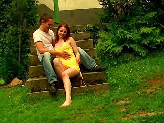 Sweet brunette chick sucks the head of a dick outdoor